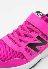 New Balance - Neutral running shoes - pink/black - 5