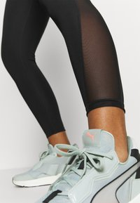 Puma - EVOSTRIPE HIGH WAIST - Tights - black - 3