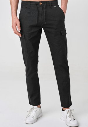 CAGLE - Cargo trousers - black