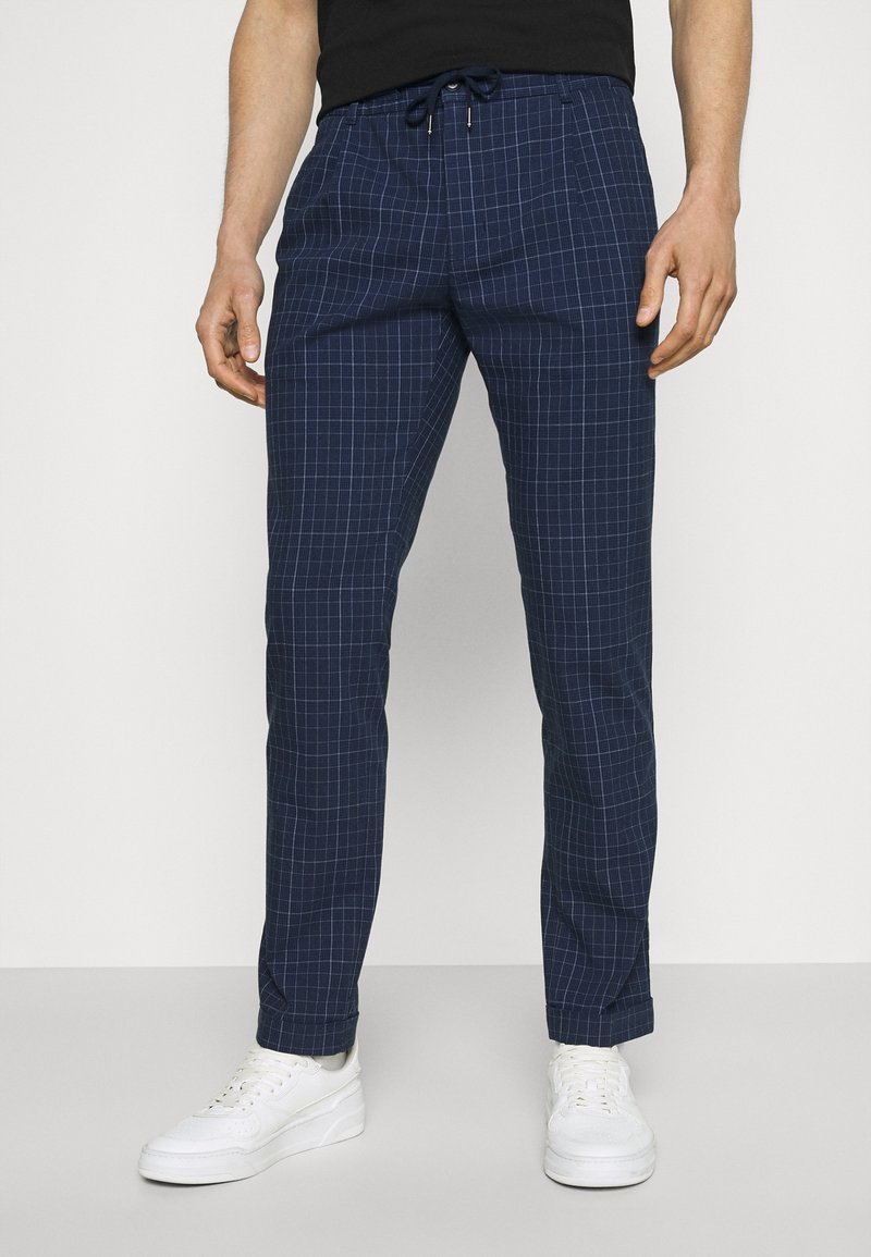 Tommy Hilfiger Tailored - DENTON ACTIVE POW CHECK TURN UP - Trousers - desert sky