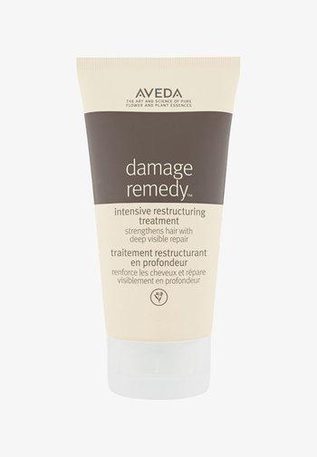 DAMAGE REMEDY™ INTENSIVE RESTRUCTURING TREATMENT  - Haarpflege - -