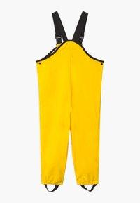 Reima - LAMMIKKO - Rain trousers - yellow - 1