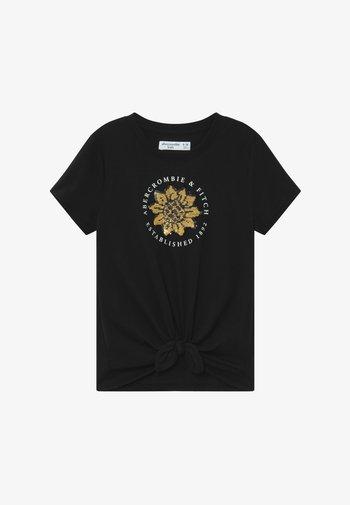JAN TIE FRONT FLIP - Print T-shirt - black