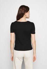 Vila - VIATHALINA V NECK  - T-shirts med print - black - 2