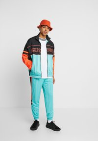 Puma - LUXTG WOVEN JACKET - Training jacket - blue turquoise - 1