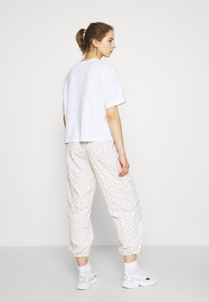 DREW PANTS - Tracksuit bottoms - tofu