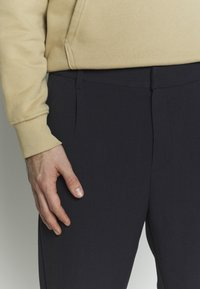 Weekday - MARD TROUSERS - Trousers - blue melange - 5