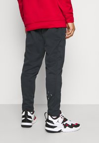 Jordan - AIR THERMA PANT - Pantalones deportivos - black/white
