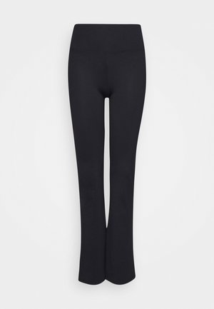 TRUMPET - Tracksuit bottoms - black
