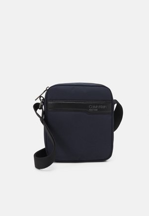 REPORTER UNISEX - Across body bag - blue