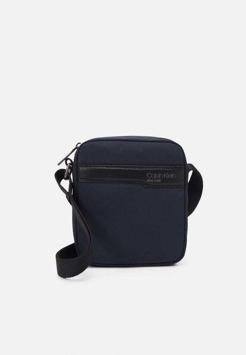 Calvin Klein - REPORTER UNISEX - Across body bag - blue