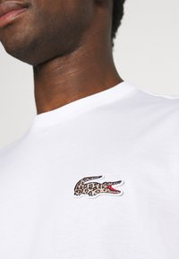 Lacoste - LACOSTE X NATIONAL GEOGRAPHIC - Long sleeved top - white - 6
