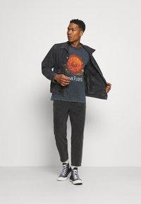Levi's® - WORK TRUCKER - Kurtka jeansowa - blacks - 1