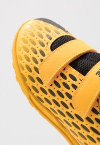 Puma - FUTURE 5.4 TT - Astro turf trainers - ultra yellow/black - 2