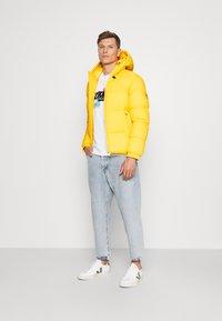 Tommy Hilfiger - HIGH JACKET - Winter jacket - amber glow - 1