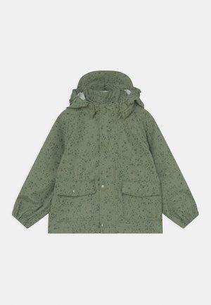 JULIEN UNISEX - Waterproof jacket - oil green