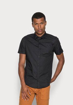 MOMBASSA - Shirt - black