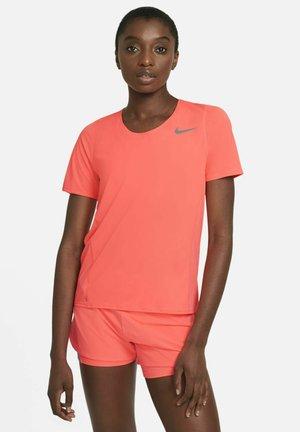CITY SLEEK - T-shirt imprimé - bright mango