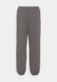 NA-KD - NA-KD X ZALANDO EXCLUSIVE - LOOSE FIT PANTS - Tracksuit bottoms - dark grey - 6