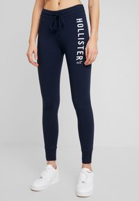Hollister Co. - TIMELESS - Tracksuit bottoms - navy - 0