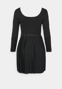 Calvin Klein Jeans - LOGO WAISTBAND PLEATED DRESS - Jersey dress - black - 6