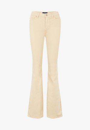 Jeans a zampa - beige