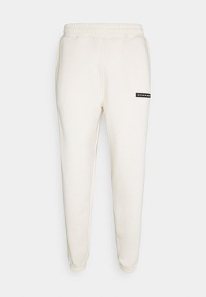 AFTERMATH RUBBER BADGE UNISEX - Pantalon de survêtement - off white