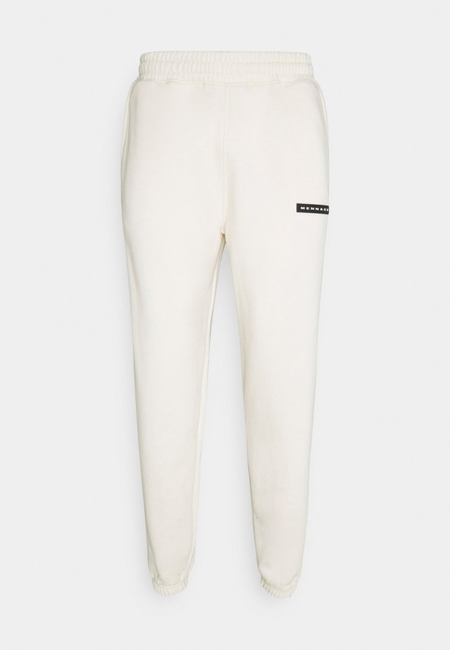 AFTERMATH RUBBER BADGE UNISEX - Tracksuit bottoms - off white