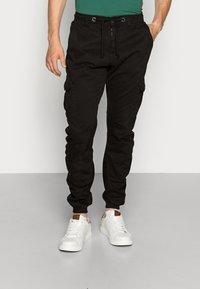 Urban Classics - Pantalon cargo - black - 0