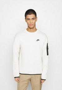 Nike Sportswear - Sudadera - light bone/black - 0