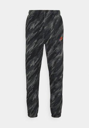 PANT - Pantalones deportivos - black/orange
