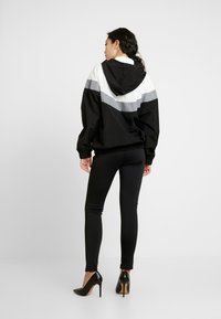 Missguided Tall - PULL-ON REFLECTIVE ZIP-UP JACKET WITH HOOD - Windbreaker - black - 2