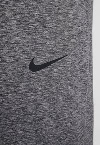 Nike Performance - M NK DRY PANT HPR DRY LT YOGA - Tracksuit bottoms - black - 5