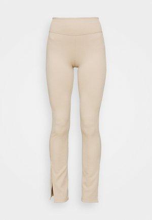 YARA SLIT - Leggings - Trousers - sand