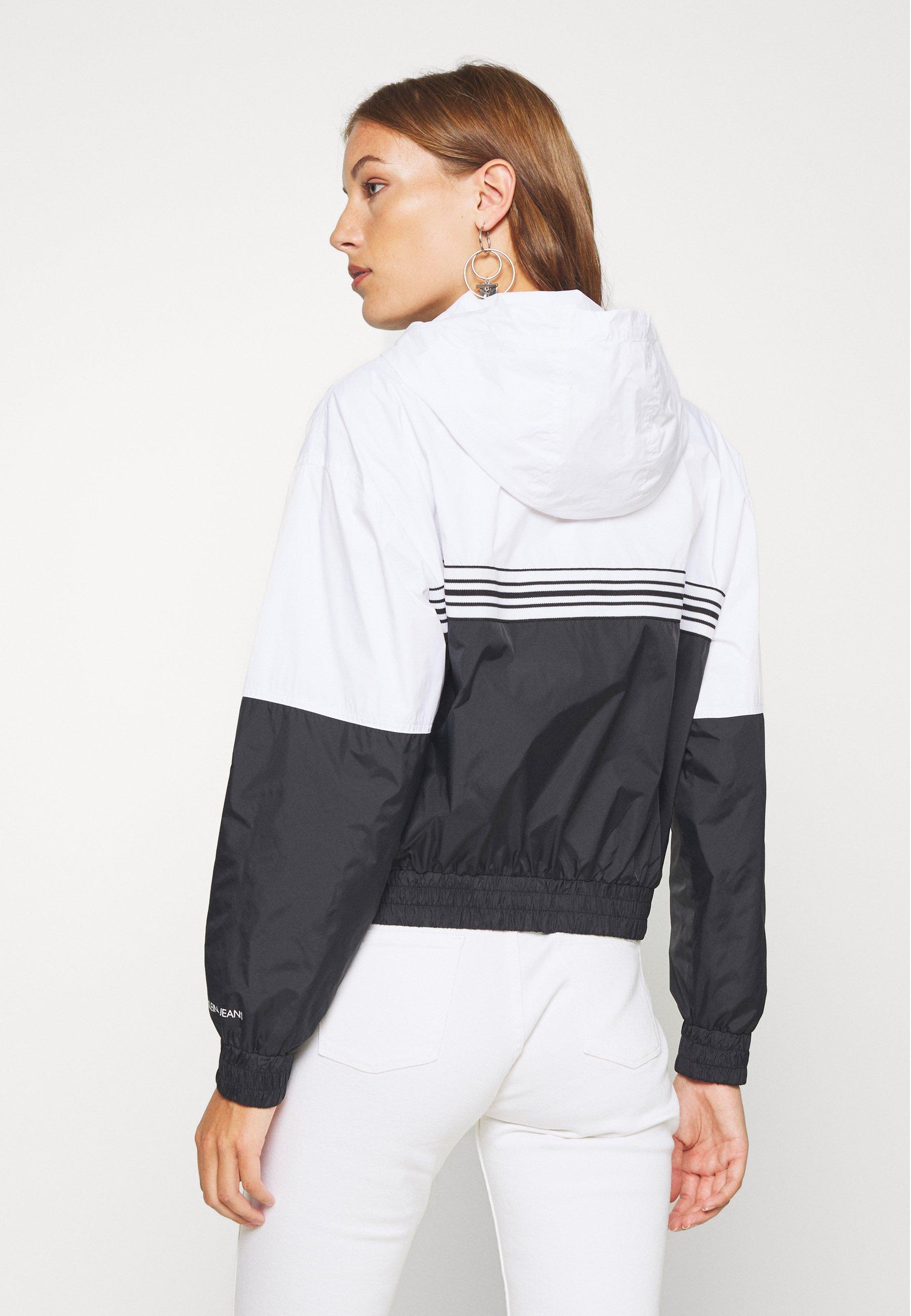 Inexpensive Women's Clothing Calvin Klein Jeans STRIPE TAPE HOODED WINDBREAKER Summer jacket black qOvtLdmE5