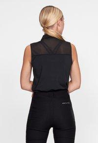 Röhnisch - MIKO  - Polo shirt - black - 2