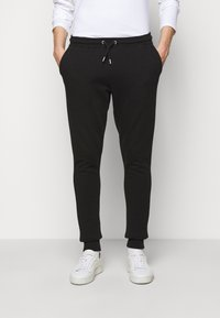 Les Deux - PANTS - Tracksuit bottoms - black/white - 0