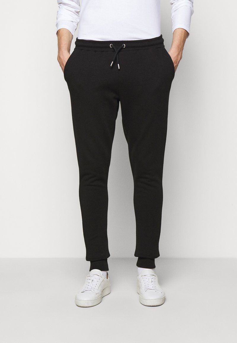 Les Deux - PANTS - Tracksuit bottoms - black/white
