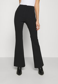 Monki - VIOLET TROUSERS - Trousers - black dark - 0