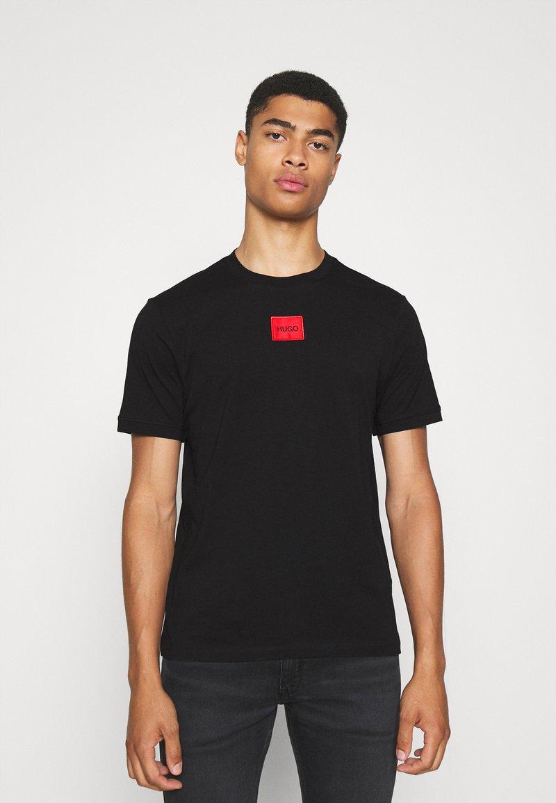 HUGO - DIRAGOLINO - Basic T-shirt - black