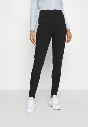CURVY HIGHEST RISE JEGGING - Slim fit jeans - black