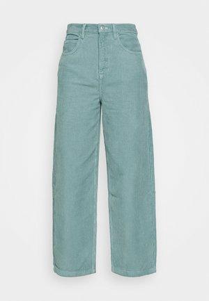 TEA BAGGY - Trousers - teal