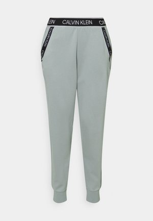 PANTS - Tracksuit bottoms - green