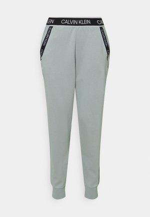 PANTS - Spodnie treningowe - green