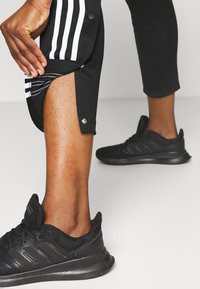 adidas Performance - SNAP PANT - Joggebukse - black - 3