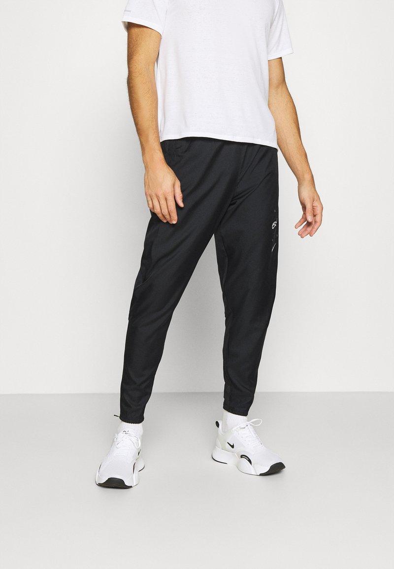 Nike Performance - PANT - Pantalon de survêtement - black