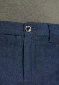 Tommy Hilfiger Tailored - DENTON HERRINGBONE - Trousers - desert sky - 3