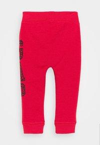 GAP - UNISEX - Trousers - modern red - 1