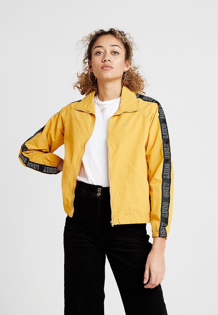 Obey Clothing - JAX TRACK ZIP - Summer jacket - mustard