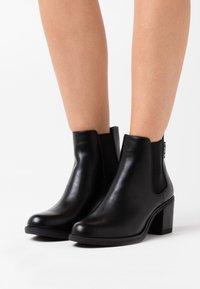 TOM TAILOR DENIM - Ankle boots - black - 0